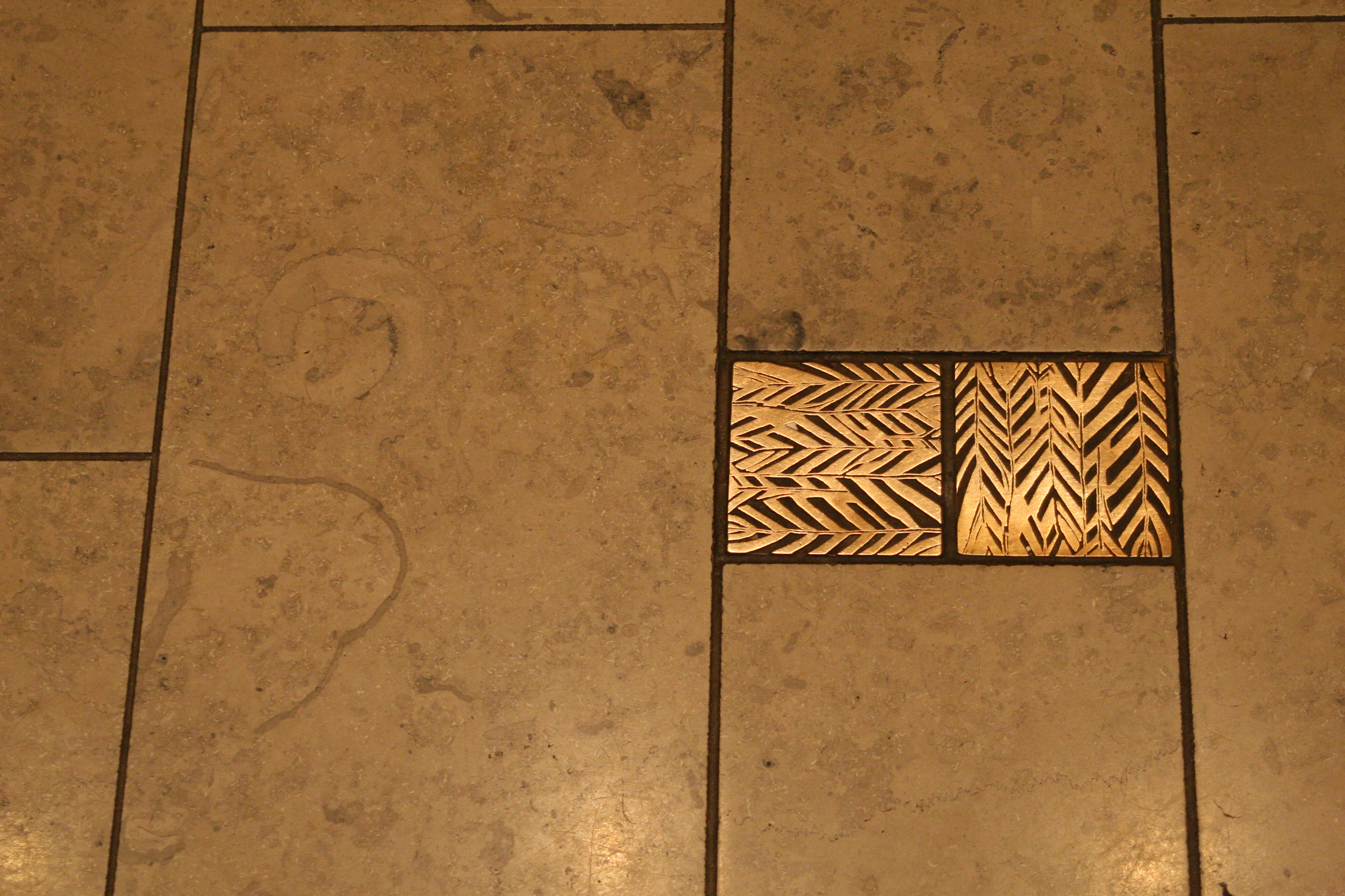 Norberry's Bronze Tile and Fossil